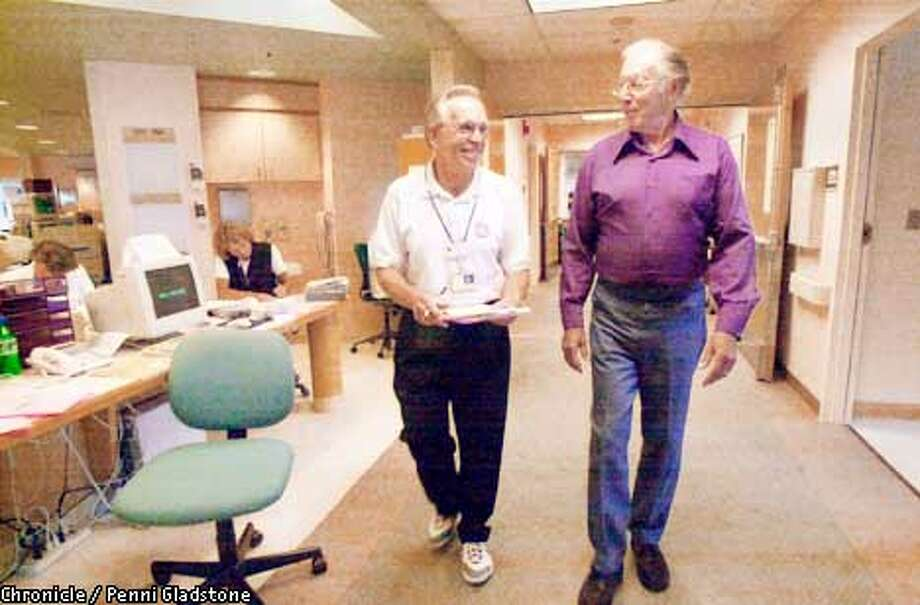 """Walking thru the hall of the ICU heart unit. Their former president, an award winning senior runner Herman Arrow at right, has survived three quardruple bypasses and the New president David Francis at left. In GREENBRAE at Marin General Hospital, is Mended Hearts, Marin Chapter, a group that helps heart patients and families survive the """"trauma"""" of stroke/surgery. this is a volunteer-based support group.  CHRONICLE PHOTO BY PENNI GLADSTONE Photo: Penni Gladstone"""