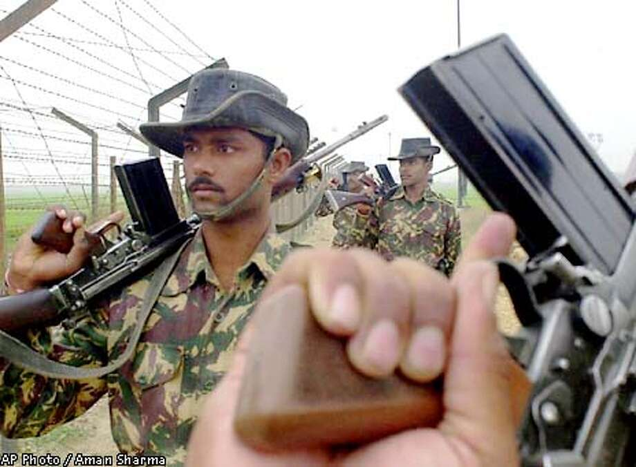 Armed Indian soldiers patrol along the fence in an undisclosed place near the international border between India and Pakistan, in the Indian state of Punjab Thursday Jan. 3, 2002. The two nuclear neighbors have increased military buildup at the border area after India accused Pakistan of harboring terrorists responsible for the Dec. 13 terrorist attack on India's Parliament. (AP Photo/Aman Sharma) Photo: AMAN SHARMA