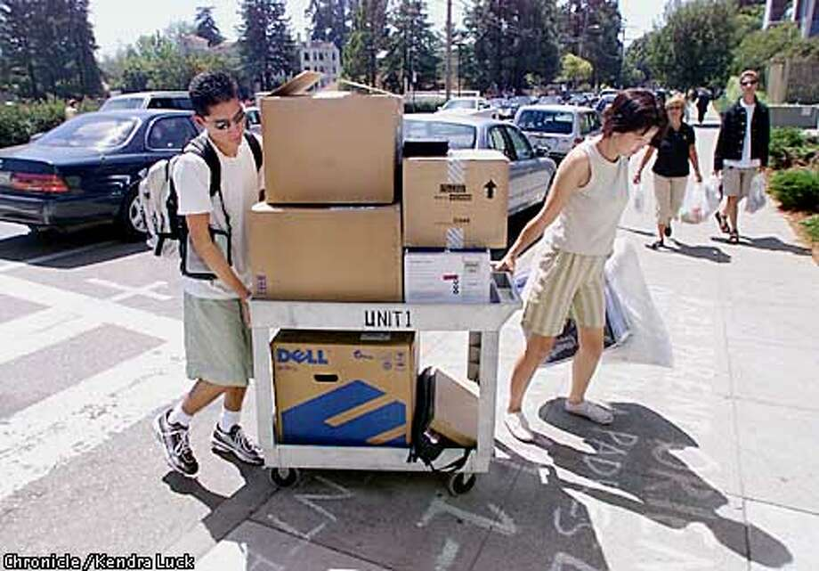 Freshman Stephen Tanaka, 17, and his mom Ann Tanaka, of Orange County, maneuver a cart of Stephen's stuff up the curb on move day at the University of California Berkeley on Sunday August 19th. (KENDRA LUCK/SAN FRANCISCO CHRONICLE) Photo: KENDRA LUCK