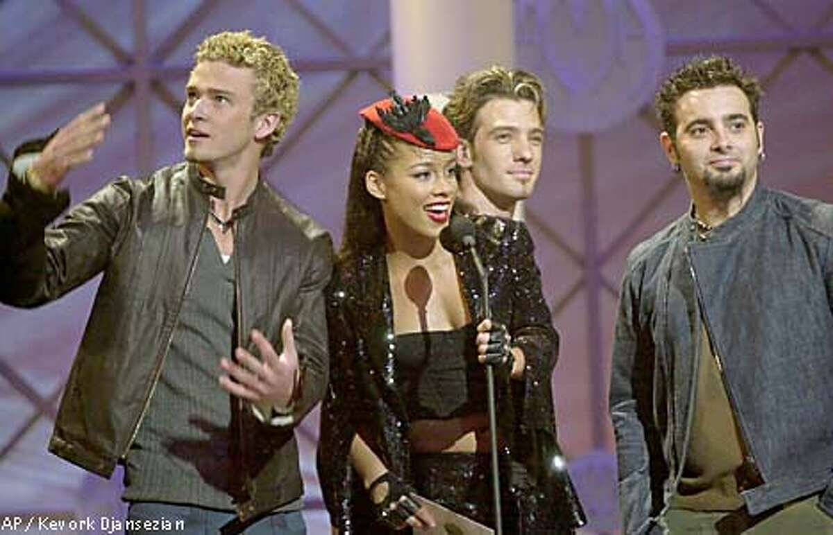 Singer Alicia Keys was joined onstage by 'N Sync members Justin Timberlake (from left), JC Chasez and Chris Kirkpatrick at the American Music Awards. Associated Press photo by Kevork Djansezian