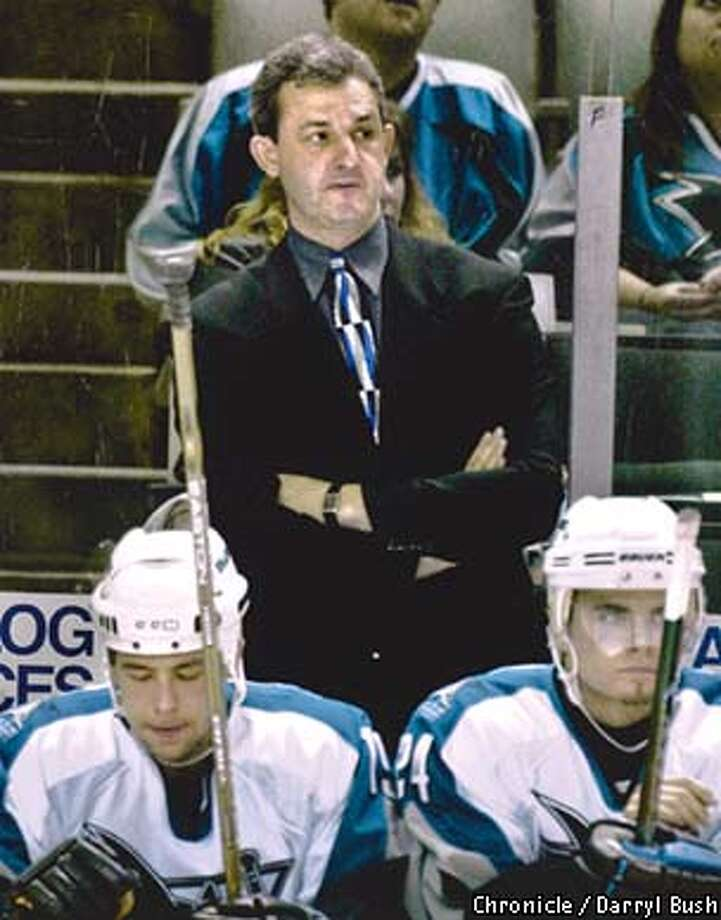 SHARKS8-C-03JAN01-SP-DB Sharks coach Darryl Sutter watches game action as the Sharks lose to Calgary at San Jose. Photo by Darryl Bush Photo: DARRYL BUSH