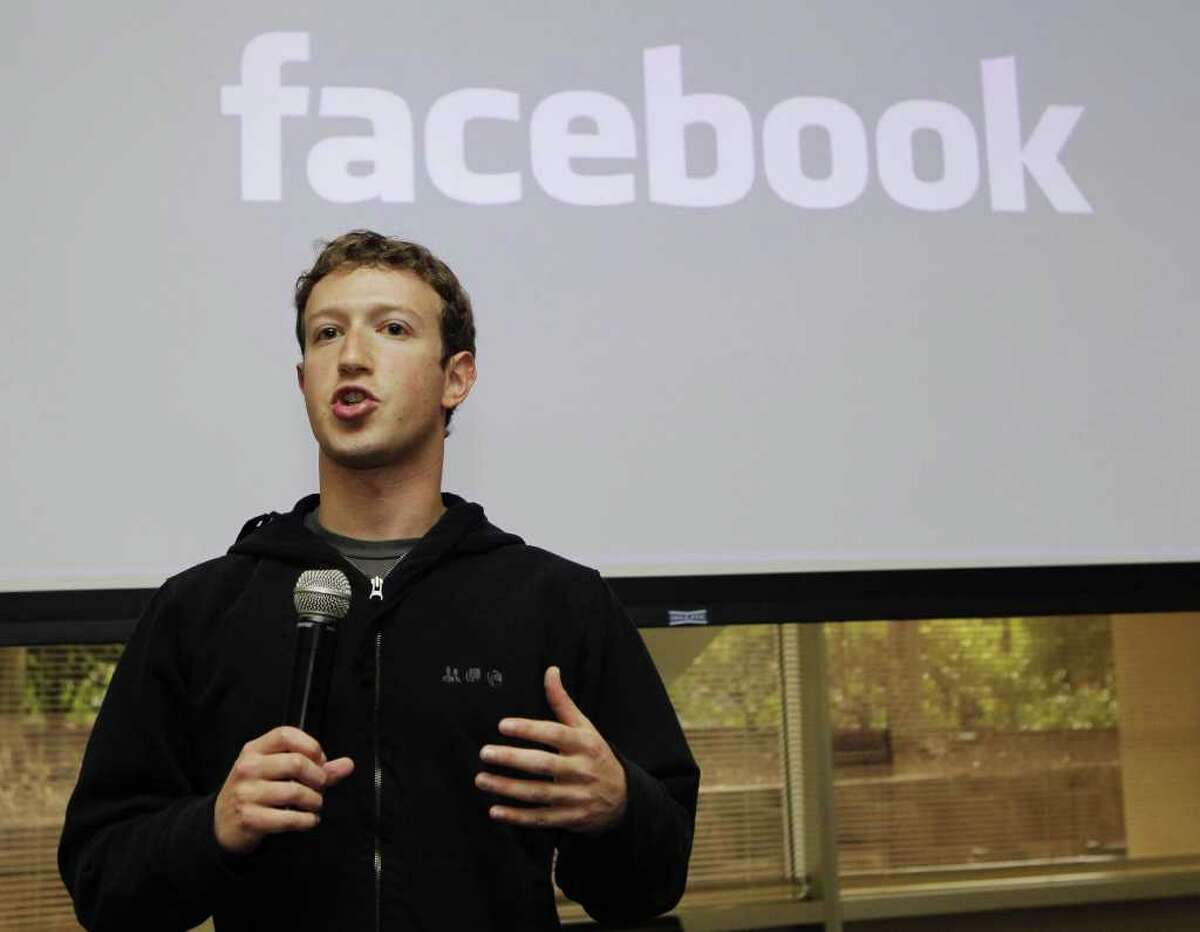 """FILE - In this May, 26, 2010 file photo, Facebook CEO Mark Zuckerberg talks about the social network site's new privacy settings in Palo Alto, Calif. Zuckerberg turns up at business conventions in a hoodie. ?""""Cocky?"""" is the word used to describe him most often, after ?""""billionaire.?"""" He was Time's person of the year at 26. So when he takes Facebook public, why would he follow the Wall Street rules? The company is expected to file as early as Wednesday, Feb. 1, 2012 to sell stock on the open market in what will be the most talked-about initial public offering since Google in 2004, maybe since the go-go 1990s. Around the nation, regular investors and IPO watchers are anticipating some kind of twist - perhaps a provision for the 800 million users of Facebook, a company that promotes itself as all about personal connections, to get in on the action. (AP Photo/Marcio Jose Sanchez, File)"""