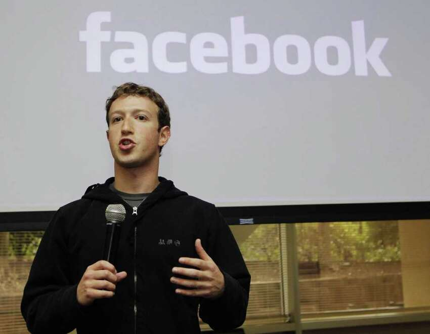 FILE - In this May, 26, 2010 file photo, Facebook CEO Mark Zuckerberg talks about the social network site's new privacy settings in Palo Alto, Calif. Zuckerberg turns up at business conventions in a hoodie. ?