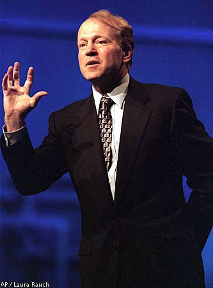 John Chambers, president and CEO of Cisco Systems, gives the keynote address at the COMDEX convention in Las Vegas on Tuesday, Nov. 16, 1999. (AP Photo/Laura Rauch) Photo: LAURA RAUCH