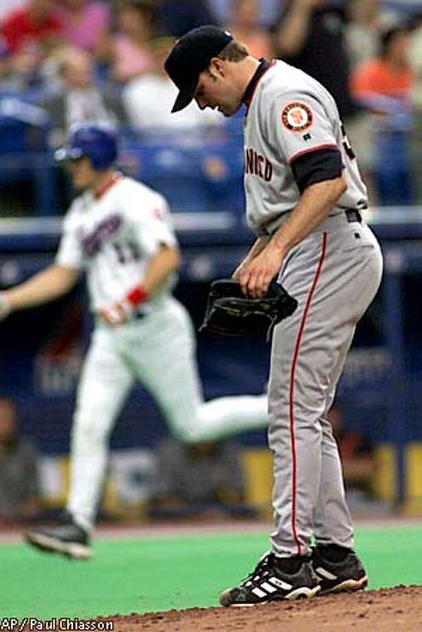 San Francisco Giants pitcher Shawn Estes reacts after giving up a three-run home run to Montreal Expos Geoff Blum, rear, scoring teammates Mark Smith and Michael Barrett during third inning NL action Wednesday Aug. 22, 2001, in Montreal. (AP Photo/Paul Chiasson) Photo: PAUL CHIASSON