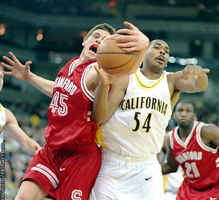 Cal/Stanford Basketball. Stanfords 45- Mark Madsen and Cal's 54- Kenyon Jones battle for a loose ball. Chronicle Photo: Michael Macor Photo: MICHAEL MACOR