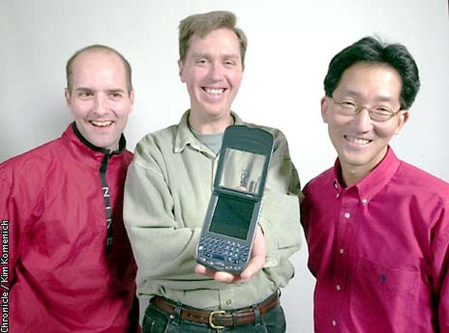 "We have a look at the new Handspring ""Treo"", a combination PDA, cell phone and internet device. L to R, designer Peter Skillman, founder and chief product officer Jeff Hawkins and marketing man Rob Haitani.  CHRONICLE PHOTO BY KIM KOMENICH Photo: KIM KOMENICH"