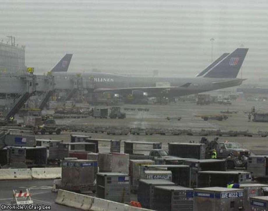 Fog at San Francisco International Airport causes delays this morning.  Photo by Craig Lee/San Francisco Chronicle Photo: CRAIG LEE
