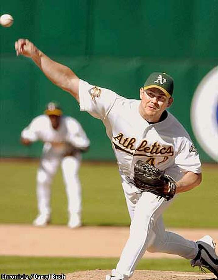 A's pitcher Jason Isinghausen closes out the game in the ninth inning despite letting two Tigers reach base escaped with the save and the A's the victory. Chronicle Photo by Darryl Bush Photo: Darryl Bush