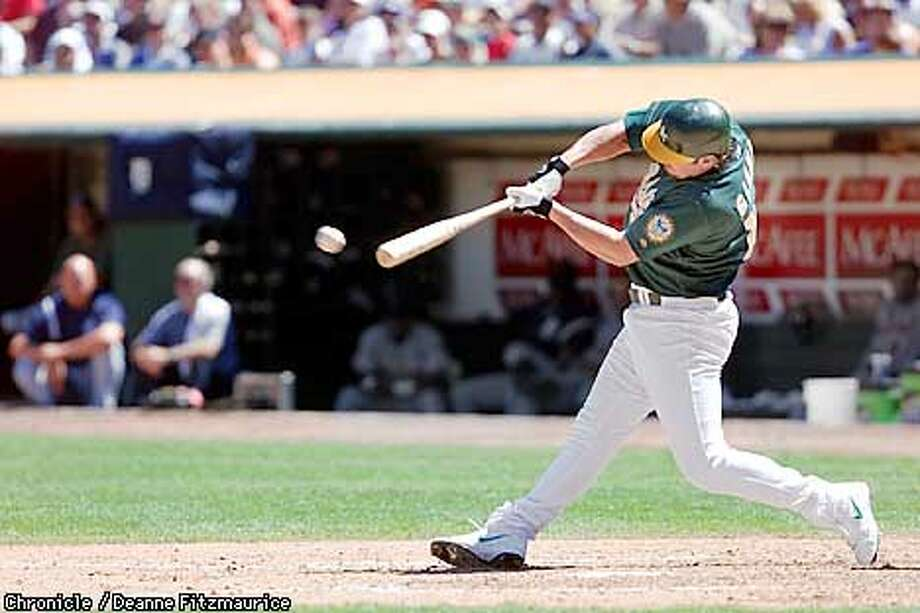 Jason Giambi hits a homerun in the 5th inning as Oakland A's beat Detroit Tigers 6-1 at Network Associates Coliseum in Oakland.  CHRONICLE PHOTO BY DEANNE FITZMAURICE Photo: DEANNE FITZMAURICE