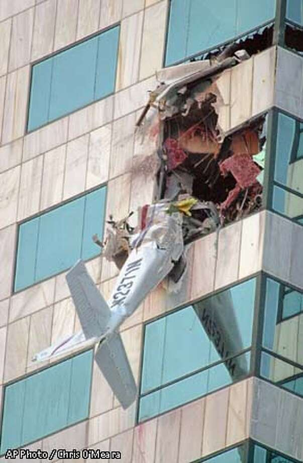 A single engine airplane crashed into the Bank of America building Saturday afternoon, Jan. 5, 2002, in Tampa, Fla. According to Tampa Fire Department spokesman Captain Bill Wade the Cessna 2000 was registered to a St. Petersburg flight school. Tampa Police Department spokesman Joe Durkin says it was not known as yet how many people were aboard the plane or in the building. (AP Photo/Chris O'Meara) Photo: CHRIS O'MEARA