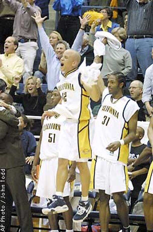 California's Shantay Legans, center, celebrates in front of teamates Jaml Sampson (31) and Dennis Gates (51) after California beat Stanford 68-54 in Berkeley, Calif., Sunday, Jan. 6, 2002. (AP Photo/John Todd) Photo: JOHN TODD