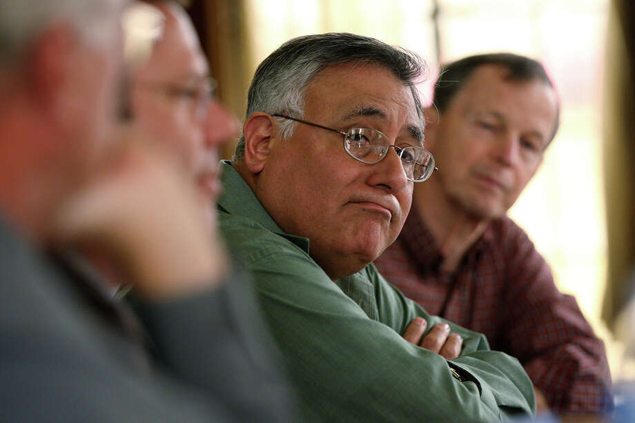 Former San Antonio Tea Party President George Rodriguez, center,  has filed a lawsuit based on allegations about streetcar funding that are off-track. Photo: Jerry Lara, San Antonio Express-News / © 2012 San Antonio Express-News