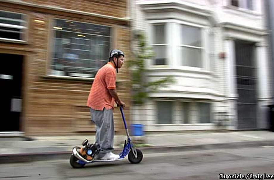 Derrick Toney, 19, of San Francisco, looking to buy a scooter, tries one out at SF Scooter, at 278 Clara Street.  Photo by Craig Lee/San Francisco Chronicle Photo: CRAIG LEE