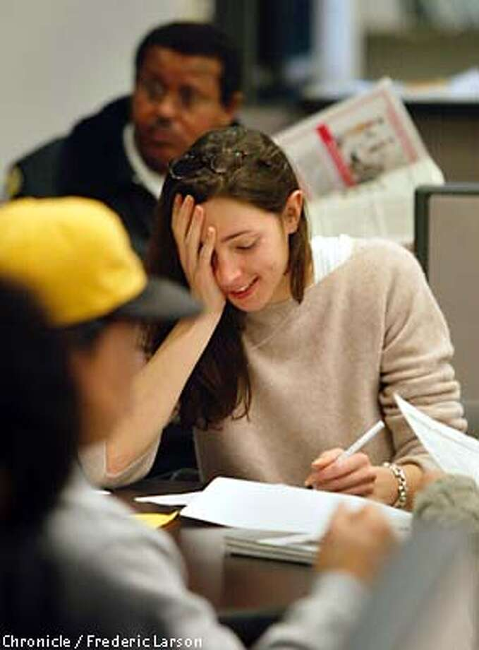 : California's unemployment benefits increase today, from the old maximum of $230 to a new high of $330. Juliet Boles of SF was one of the people at SF unemployment center waiting to file so they could get the higher rate. Chronicle photo by Frederic Larson Photo: FREDERIC LARSON