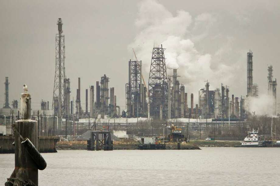 Refineries along the Ship Channel are just part of Houston's pollution picture. Photo: Michael Paulsen / Houston Chronicle
