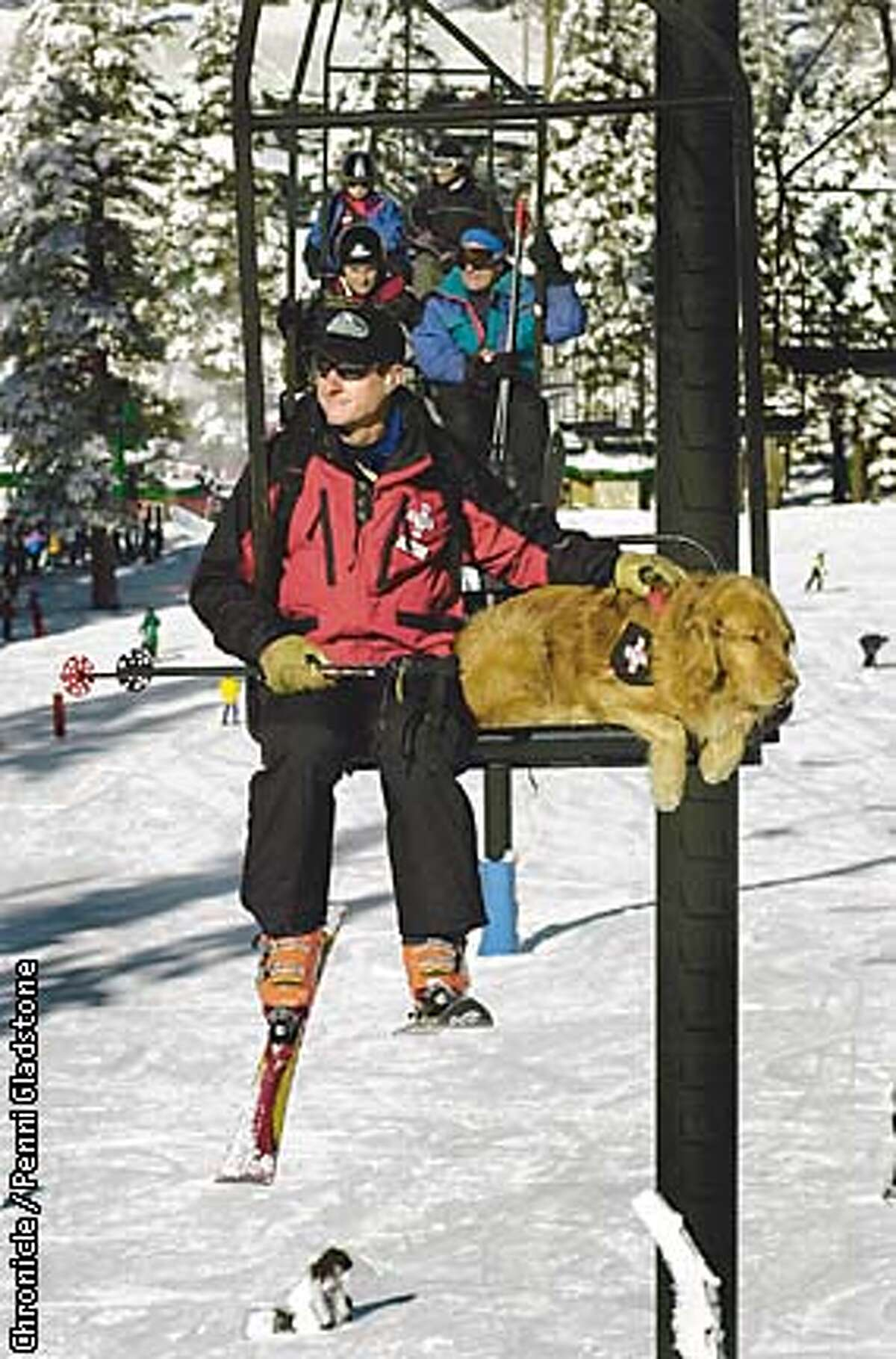 Jim Goldstone, a ski patroler at Alpine Meadows Ski Resort rides the ski lift with his search and rescue dog Zachery. The dog has to be used to riding on a chopper and snowmobile too. PHOTOGRAPHY BY PENNI GLADSTONE