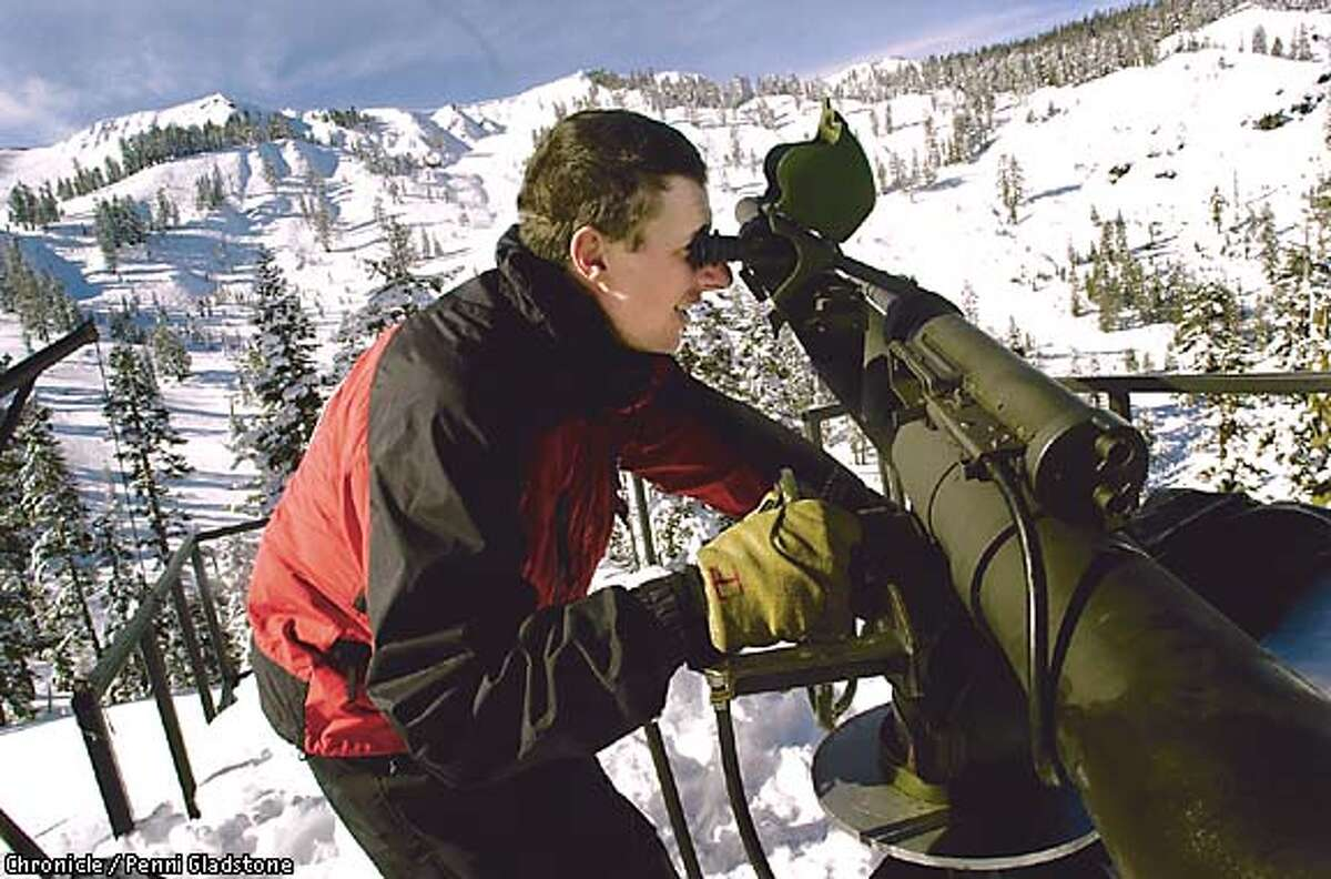 Jim Goldstone, a ski patroler at Alpine Meadows Ski Resort , Looks thru the viewfinder of the 106mm recoiless rifle which clears areas of snow considered an avalance hazard. PHOTOGRAPHY BY PENNI GLADSTONE