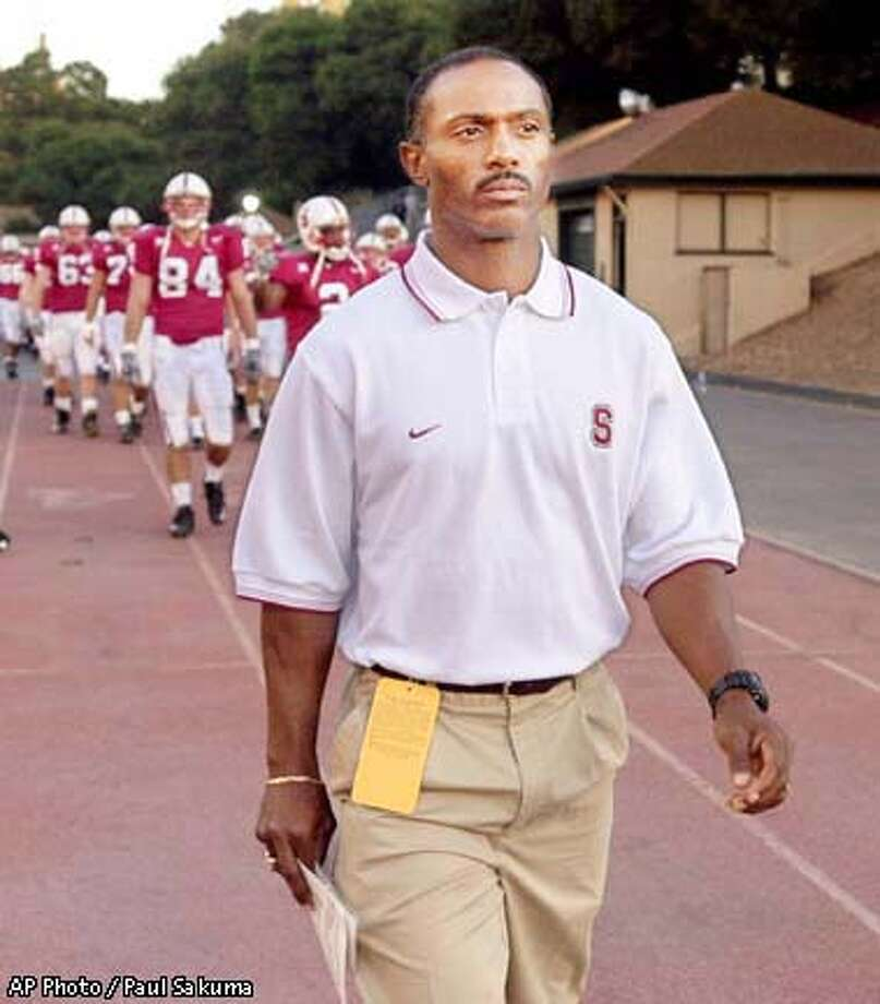 FILE--Stanford coach Tyrone Willingham leads his team onto the field to face San Jose State, Sept. 9, 2000, at Stanford Stadium in Stanford, Calif. Notre Dame was close to hiring Willingham as its football coach in a deal that could be completed as early as Monday, Dec. 31, 2001, The Associated Press has learned. If hired, Willingham would become the first black head coach in any sport for the Fighting Irish. (AP Photo/Paul Sakuma, File) Photo: PAUL SAKUMA