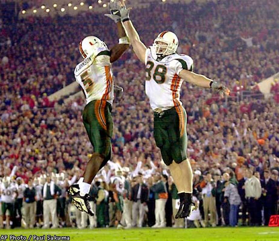 Miami's Andre Johnson (5) celebrates his second touchdown against Nebraska with teammate Jeremy Shockey (88) during the second quarter of the 88th in Pasadena, Calif., Thursday, Jan. 3, 2002. (AP Photo/Paul Sakuma) Photo: PAUL SAKUMA