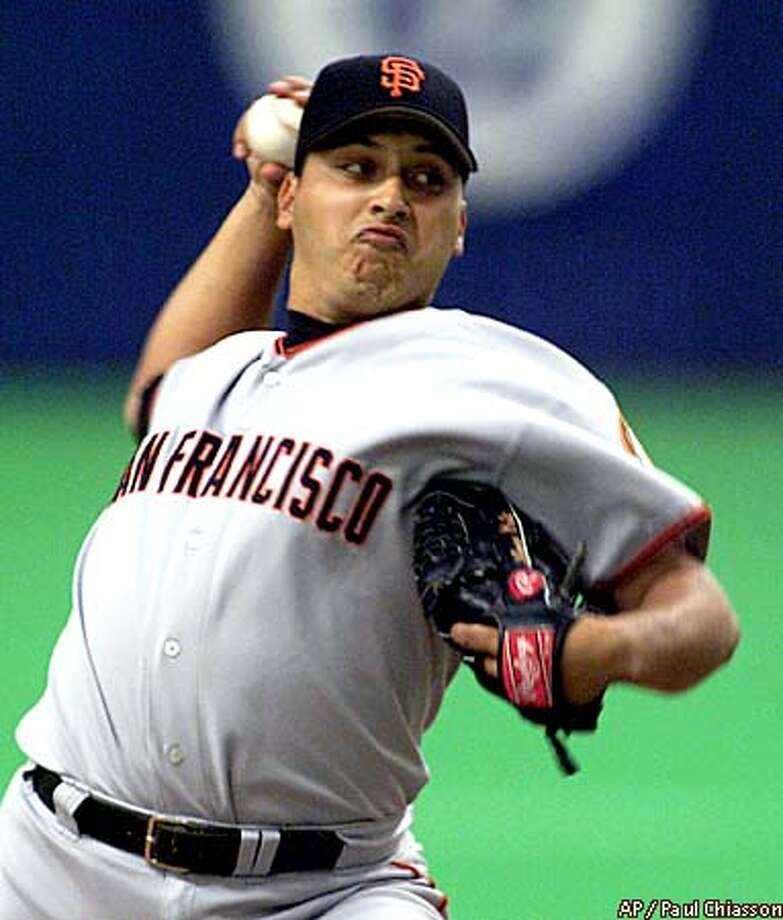 San Francisco Giants pitcher Russ Ortiz winds up for the throw to a Montreal Expos batter during sixth inning NL action Tuesday August 21, 2001, in Montreal. (AP Photo/Paul Chiasson) Photo: PAUL CHIASSON