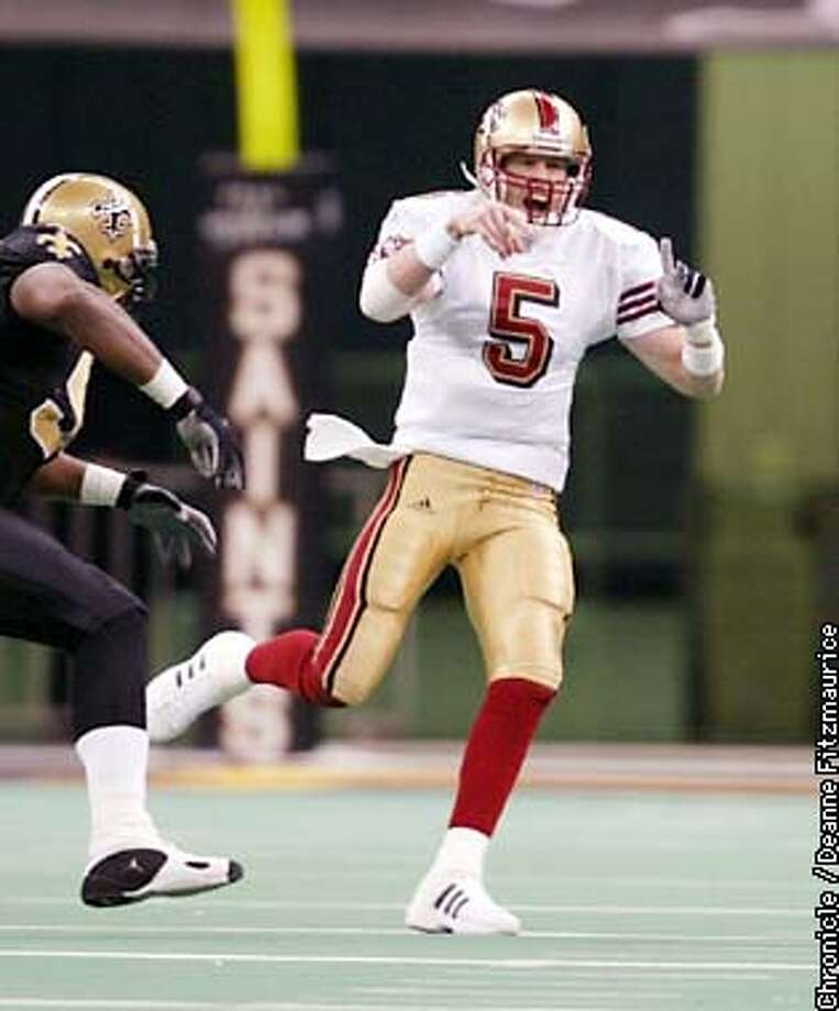 Jeff Garcia completes a long pass as San Francisco 49ers beats New Orleans Saints 38-0 at the Superdome in New Orleans.  CHRONICLE PHOTO BY DEANNE FITZMAURICE Photo: DEANNE FITZMAURICE