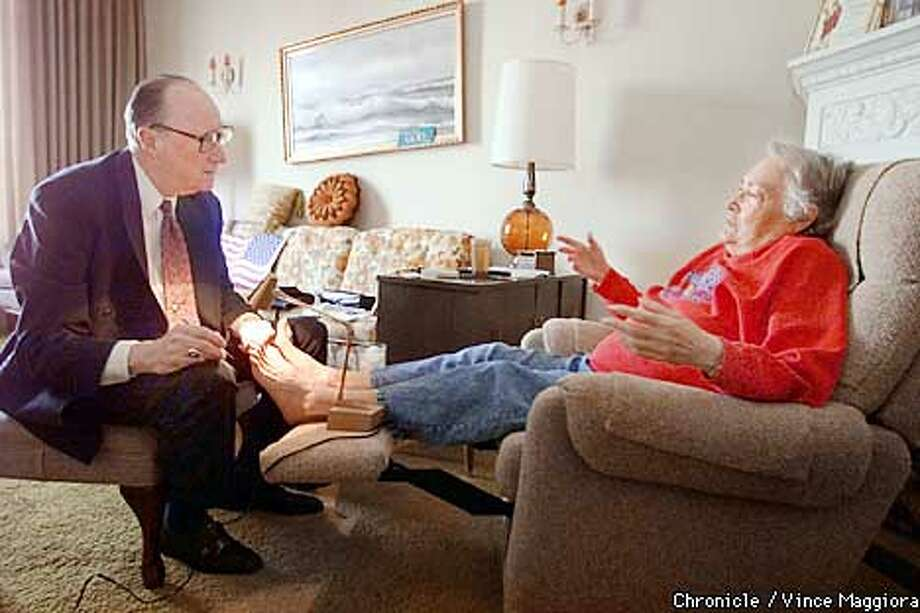 Dr. Willard McDonald a foot doctor who makes house calls,working on the foot of Nanette Bergeron in her SF home. by Vince Maggiora Photo: VINCE MAGGIORA