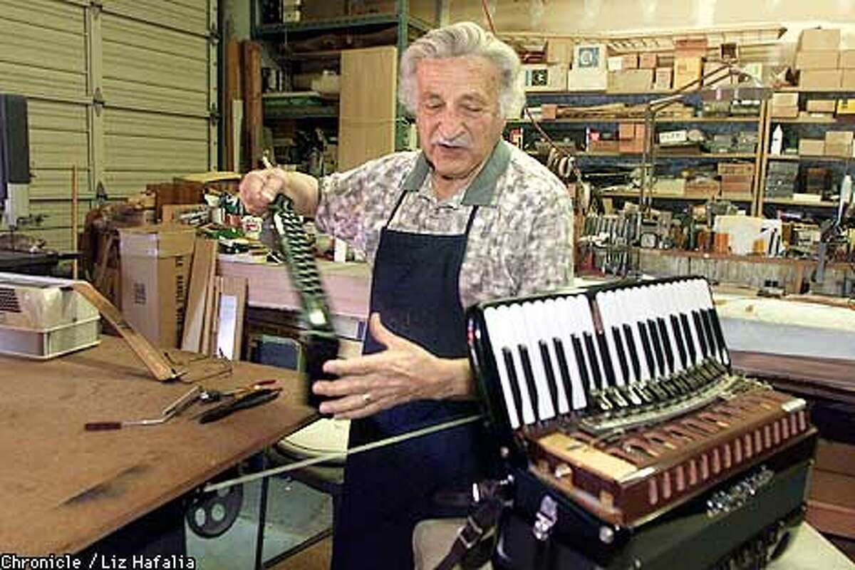 Vince Cirelli is the last factory-trained accordion repairman in the Bay Area. He is repairing an accordion whose key was damaged. (BY LIZ HAFALIA/THE SAN FRANCISCO CHRONICLE)