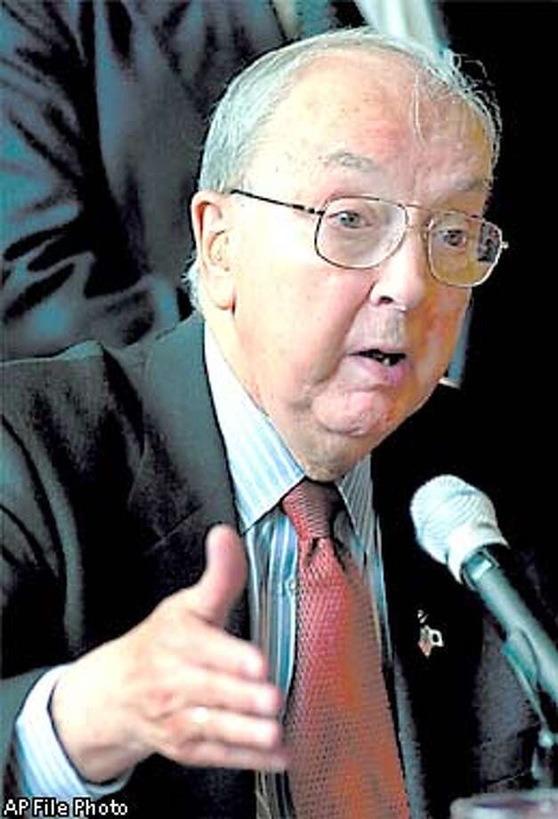FILE--U.S. Sen. , R-N.C., speaks during a press conference at Mexico's Senate in this April 18, 2001 file photo, in Mexico City. Helms, one of the most conservative Republicans in Congress, plans to announce Wednesday, Aug. 22, 2001 that he will retire when his term expires in 2003, The Associated Press has learned. (AP Photo/Jose Luis Magana, File) Photo: JOSE LUIS MAGANA