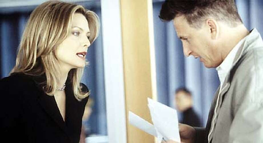 Michelle Pfeiffer and Sean Penn in the movie I Am Sam. HANDOUT.