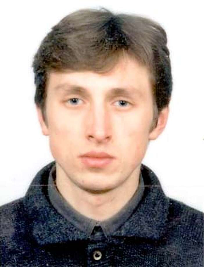 Passport photo of Nikolay Soltys released by the Sacramento County Sheriff's Department August 23, 2001. California police kept up a desperate hunt for mass murder suspect Nikolay Soltys on Thursday, painting a picture of the 27-year-old Ukrainian immigrant as a cold-blooded criminal who thought nothing of killing six family members including his own 3-year-old son. Police said they were fielding hundreds of tips on Soltys' possible whereabouts, but were focusing on what they called a credible witness report putting the suspect still in the Sacramento area. REUTERS/HO/Sacramento County Sheriff's Department Photo: HO