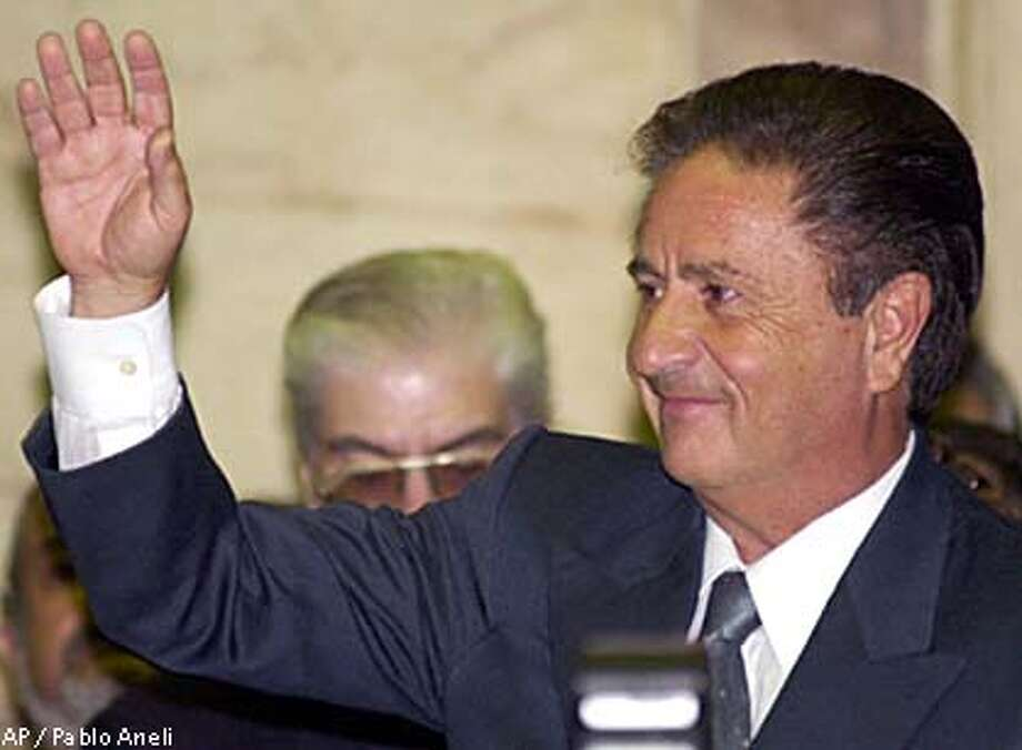 Eduardo Duhalde will serve as president until 2003. Associated Press photo by Pablo Aneli