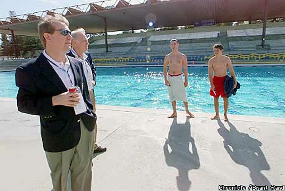 Two visiting United States Olympic dignitaties stopped to talk with lifeguards , l-r, Jarrod Jones and Justin Karp at the George Haines International Swim Center in Santa Clara. Greg Harney, left and former olympian Charles H. Moore took a moment to talk to the young swimmers as the swim center as a setting for the 2012 Olympics. By Brant Ward/Chronicle Photo: BRANT WARD