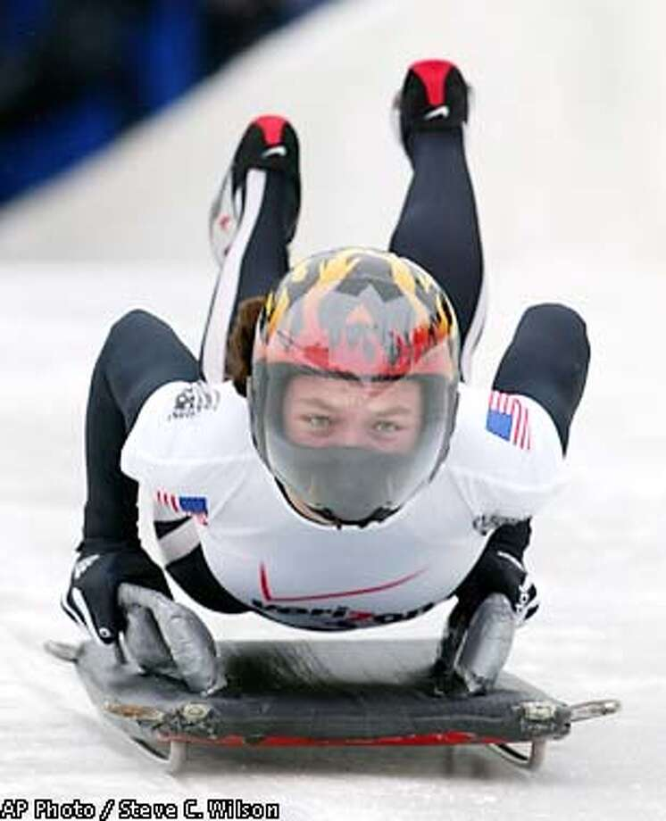 Lea Ann Parsley of the USA women's skeleton team dives onto her sled as she starts down the track to a first-place finish in the Olympic trials at the Utah Olympic Park, Sunday, Dec. 30, 2001, in Park City, Utah. (AP Photo/Steve C. Wilson) Photo: STEVE C. WILSON