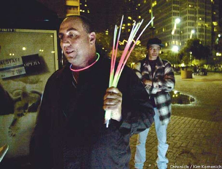 Early pics from New Years festivities near the Embarcadero. Bill Capra of Brooklyn, New York is hoping to clean up with neon necklaces he will sell for $3 each.  CHRONICLE PHOTO BY KIM KOMENICH Photo: KIM KOMENICH