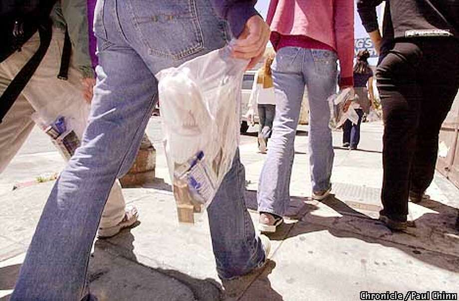 High school and college students distributed plastic bags containing socks, condoms, toothbrushes, and candy to prostitutes in the Mission district.  PAUL CHINN/S.F. CHRONICLE Photo: PAUL CHINN
