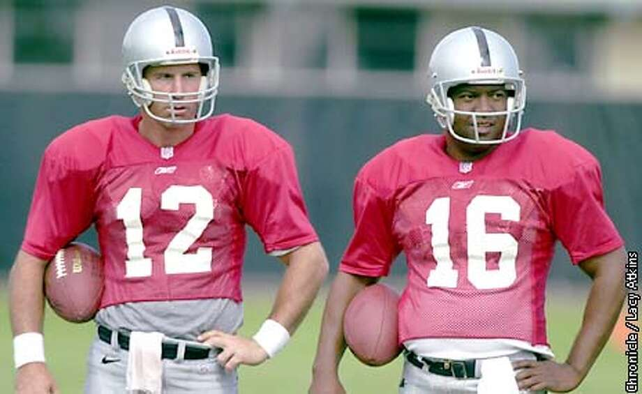 Raiders quarterbacks Rich Gannon and Rodney Peete stand along the sidelines during a play at camp, Tue. July24 01, in Napa. Photo By Lacy Atkins/SanFrancisco Chronicle Photo: Lacy Atkins