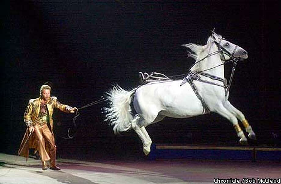 CIRCUS17c-C-15AUG01-DD-BM  Opening night of Ringling Bros and Barnum and Bailey Circus in the Oakland Coliseum.Mark Oliver Gebel and one of his Liberty Horses makes a jump  Chronicle photo by Bob McLeod
