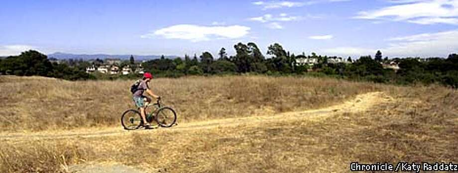 Photo by Katy Raddatz--The Chronicle  The Arana Gulch Greenbelt in Santa Cruz is used by many folks, but environmentalists in Santa Cruz think bicycles are an environmental hazard. We visit the greenbelt area to see what's happening. SHOWN: a bicyclist rides the dirt trail. Photo: KATY RADDATZ