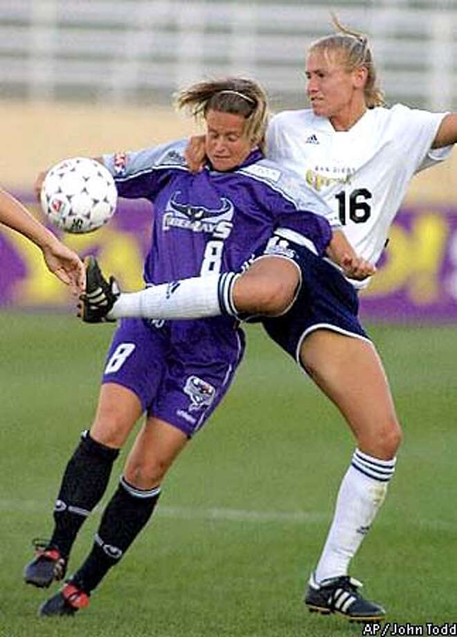 San Diego Spirit's Kim Pickup, right, and Bay Area CyberRays' Julie Murray, left, battle for the ball in the first half at Spartan Stadium in San Jose, Calif., Wednesday, July 25, 2001. (AP Photo/John Todd)