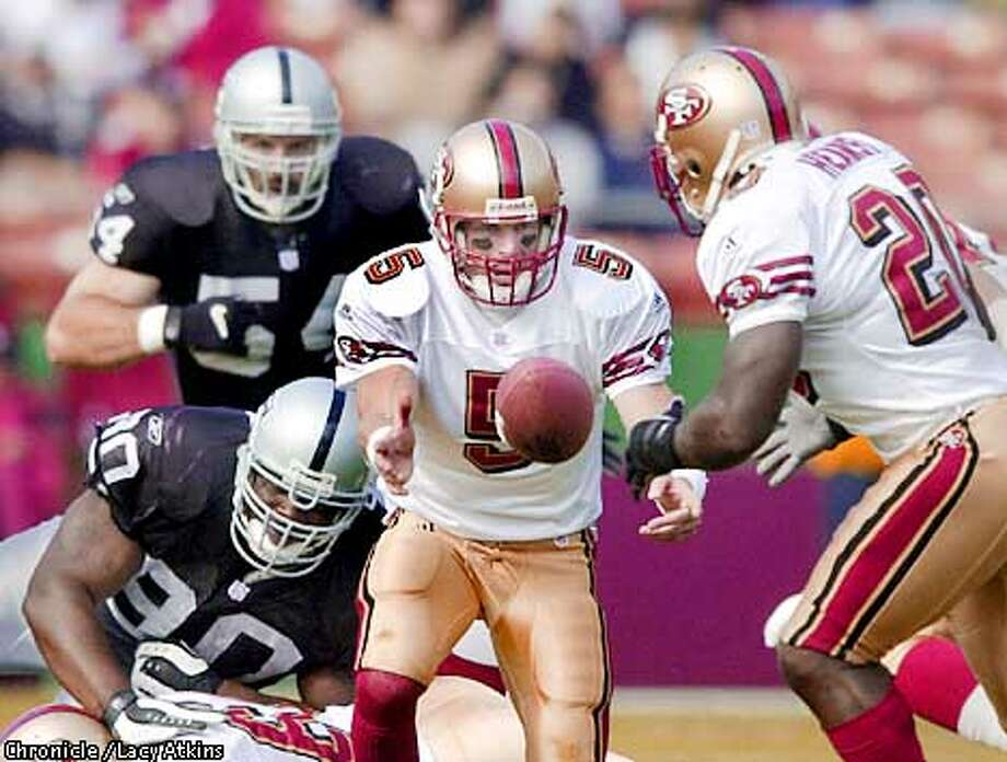 Jeff Garcia kicks the ball out to Garrison Hearst. The San Francisco 49ers played the Oakland Raiders during preseason action at 3com Park on Sunday, August 19, 2001. (Photo by Lacy Atkins/The San Francisco Chronicle) Photo: Lacy Atkins