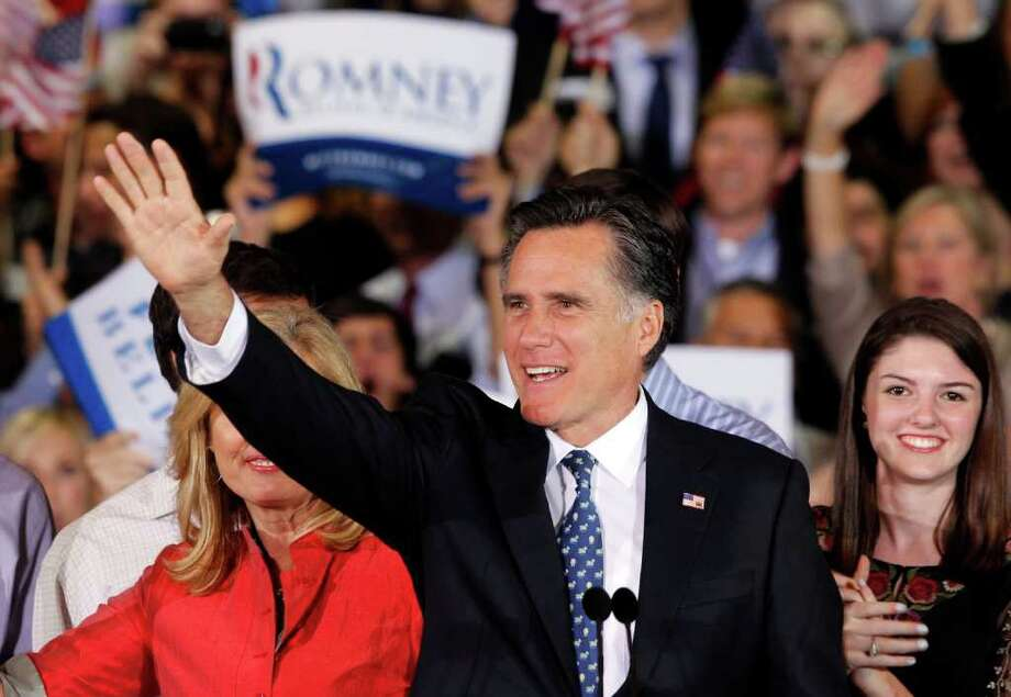 Republican presidential candidate, former Massachusetts Gov. Mitt Romney waves during his victory celebration after winning the Florida primary election Tuesday Jan. 31, 2012, in Tampa, Fla. (AP Photo/Gerald Herbert) Photo: Gerald Herbert, Associated Press / AP