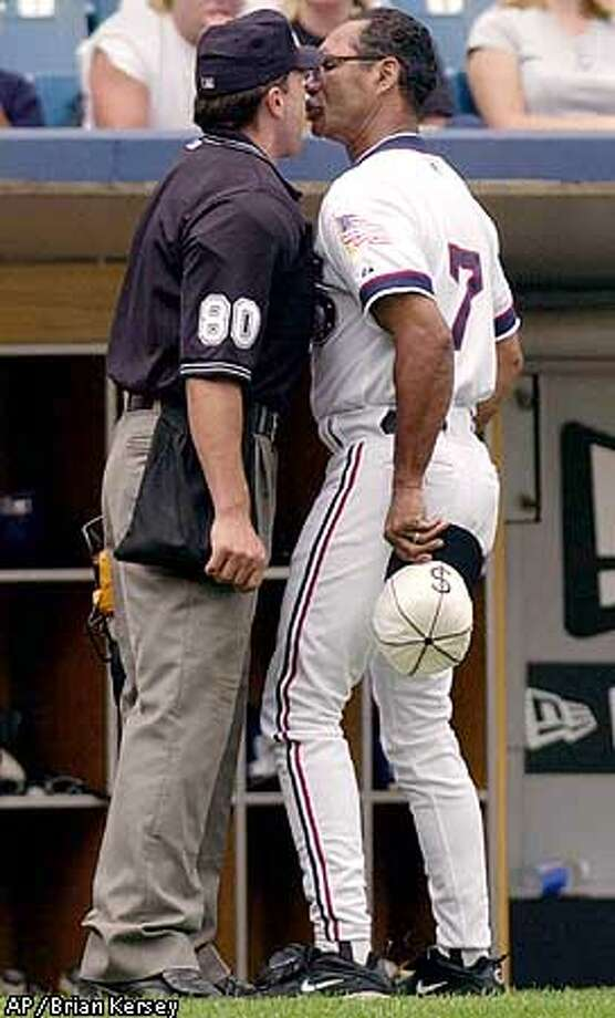 Chicago White Sox manager Jerry Manuel argues a call with home plate umpire Mike Fichter in the fifth inning of the game against the Oakland Athletics on Sunday, Aug. 19, 2001 in Chicago. Manuel, was ejected arguing balls and strikes. The White Sox lost 8-7. (AP Photo/Brian Kersey) Photo: BRIAN KERSEY