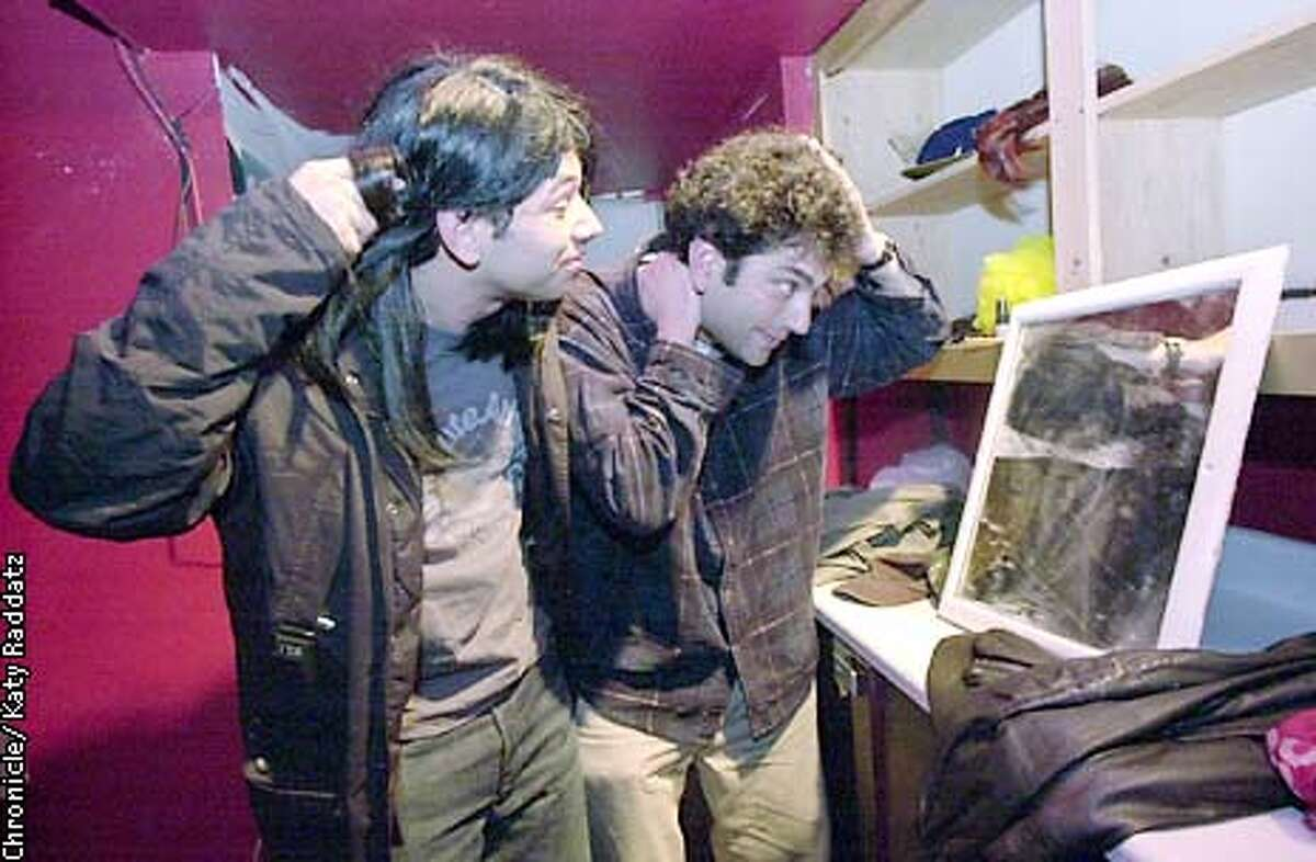 Photo by Katy Raddatz--The Chronicle Local comedy groups get together for a 3 week festival at the Shelton Theater 533 Sutter St. SF. SHOWN: guys looking in mirror are The Fresh Robots Al Madrigal (L) and Mike Spiegelman (R). They're putting final touches on their wigs.