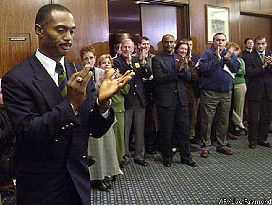 Tyrone Willingham applauded as he was introduced as the coach of the Fighting Irish in South Bend, Ind. Associated Press photo by Joe Raymond