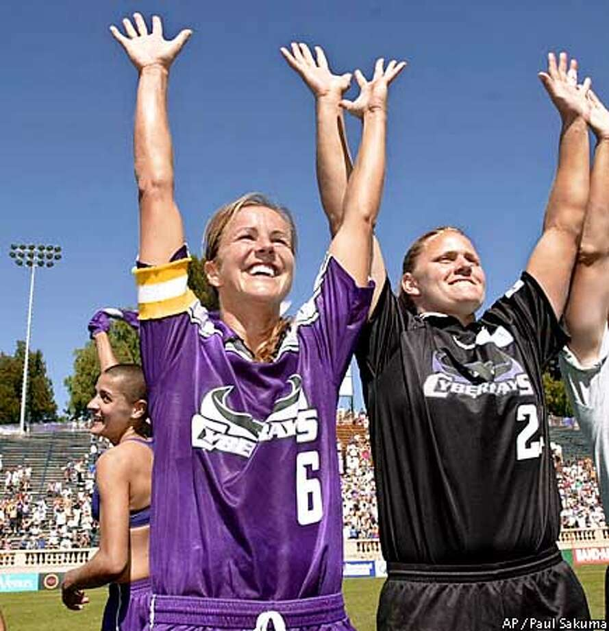 Bay Area CyberRays Sissi, left, Brandi Chastain (6) and goalkeeper Jennifer Mead celebrate after the CyberRays defeated the New York Power 3-2 in the semifinals of the WUSA playoffs in San Jose, Calif., Saturday, Aug. 18, 2001. (AP Photo/Paul Sakuma) Photo: PAUL SAKUMA