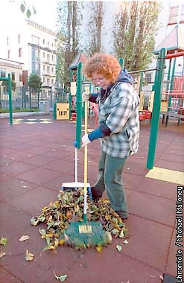 SF city gardeners at work. SF gardener Sandra Choate rakes leaves in Macauley Park in the heart of the Tenderloin.  CHRONICLE PHOTO BY MICHAEL MALONEY Photo: MICHAEL MALONEY