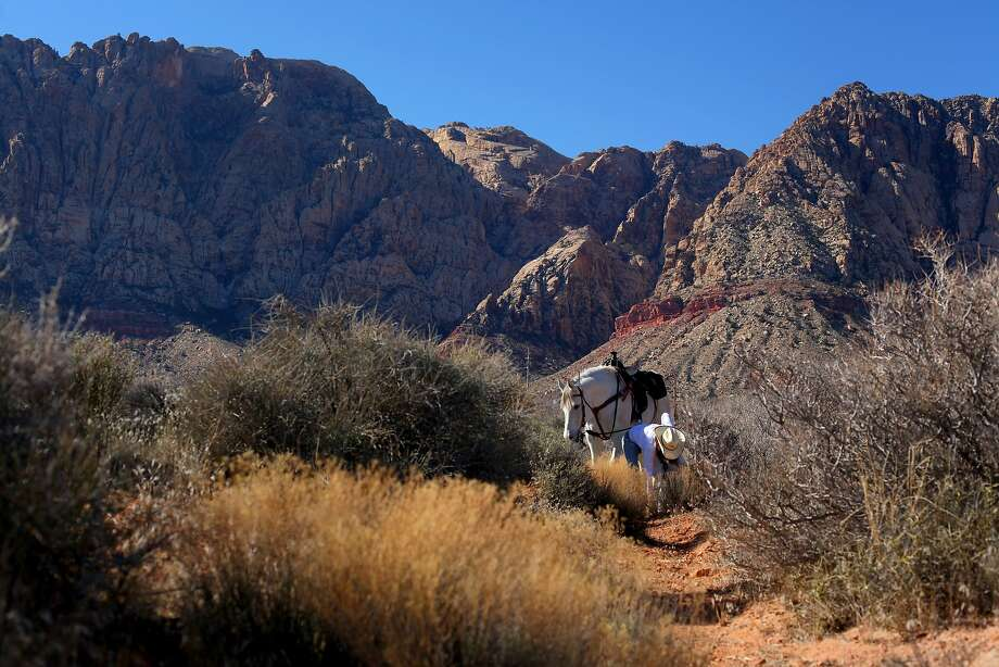 Many Bay Area residents could make good use of the outdoor active gear they regularly wear, from Lululemon to 'Patagucci,' at the parks and preserves surrounding Las Vegas, such as the Red Rock Canyon National Conservation Area. Pictured: Catherine Springer walks her horse Nasheti  through Red Rock Canyon while cleaning up the trash, Tuesday January 31, 2010, in Las Vegas, Nevada. Photo: Lacy Atkins, The Chronicle