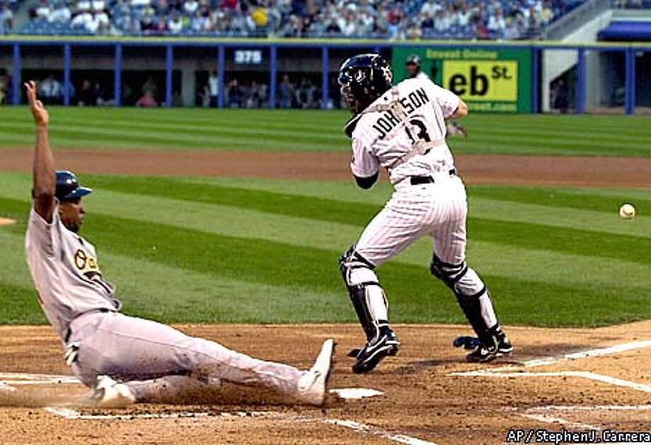 Oakland Athletics' Jermaine Dye slides into home from second on a Miguel Tejada single as Chicago White Sox catcher Mark Johnson (8) misses the throw during the first inning Friday, Aug.17, 2001, in Chicago. (AP Photo/Stephen J. Carrera) Photo: STEPHEN J. CARRERA