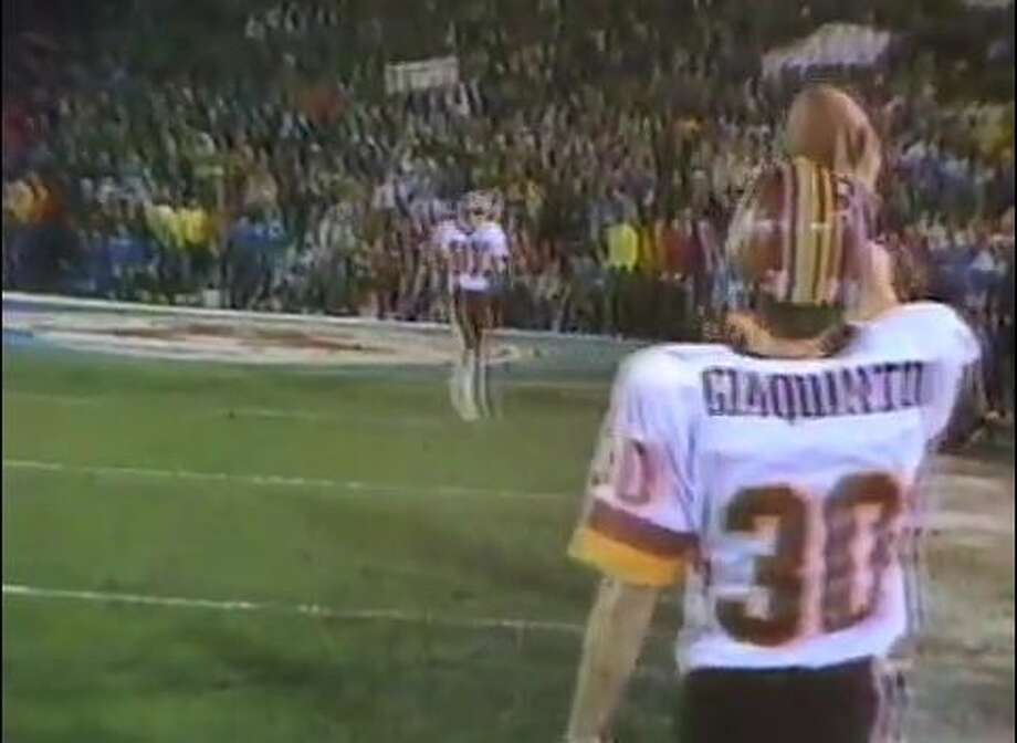 In this screen capture from Super Bowl XVII between the Washington Redskins and Miami Dolphins,  Stratford native and Redskins' back  Nick Giaquinto (30) waits for teammate Charlie Brown (87) after Brown's 6-yard touchdown in the fourth quarter.